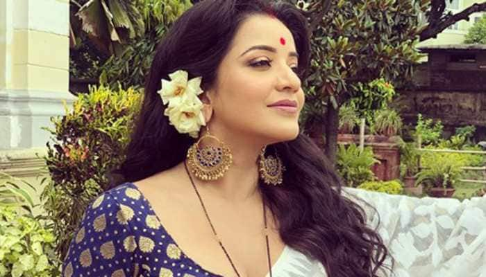 Monalisa sizzles in sheer white saree, enjoys being a 'water baby' - See pics