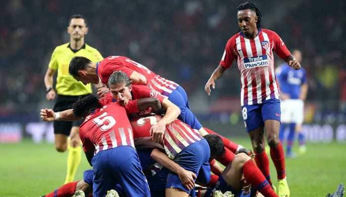 Atletico Madrid enjoy late goal from Godin in 3-2 win over Bilbao