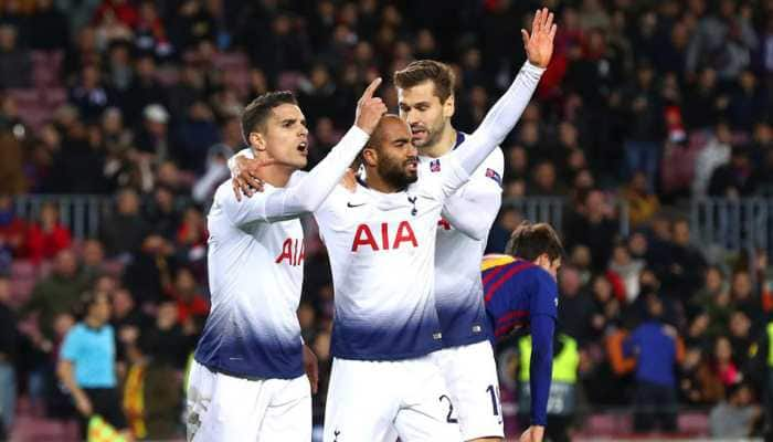 UEFA Champions League: Spurs reach last 16 as Moura snatches draw at Barca