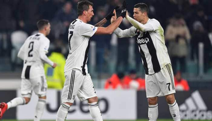 Juventus beat Roma to stay undefeated in Serie A
