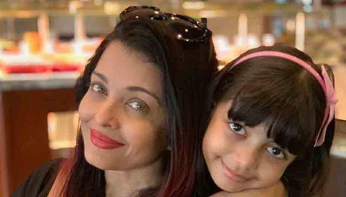 Abhishek Bachchan shares a 'cuddled up' photo of wife Aishwarya Rai Bachchan with daughter Aaradhya