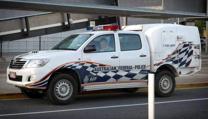 Australian police charge man over hazardous parcels sent to diplomatic offices