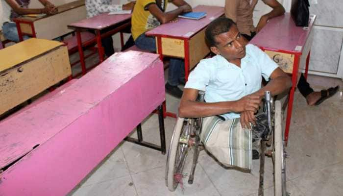 Hitchhiking with a wheelchair in war-torn Yemen