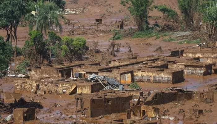 Seven bodies found after dam burst at Brazil mine, hundreds missing