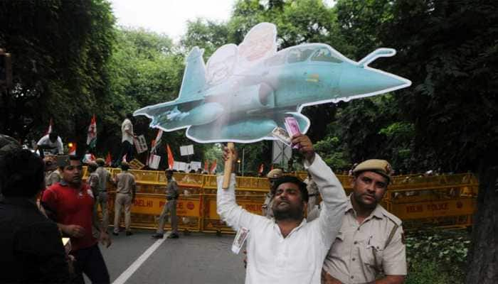 CAG report on Rafale deal tabled even as Congress leaders fly paper planes outside Parliament