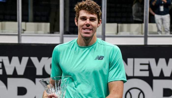 Reilly Opelka earns first Tour title with New York Open win over Brayden Schnur