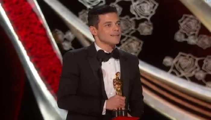 Rami Malek falls off Oscars stage