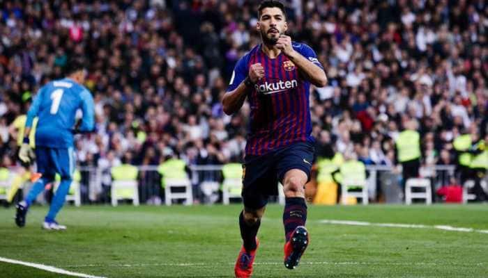 Luis Suarez double helps Barcelona triumph 3-0 against arch-rivals Real Madrid