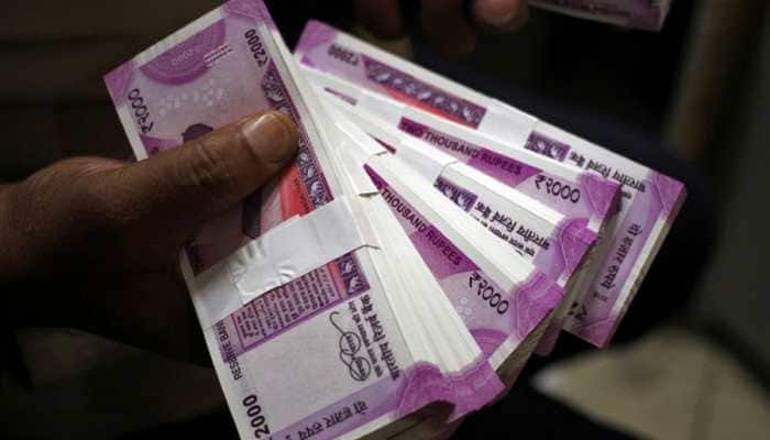 Rupee appreciates 15 paise to 69.99 against US dollar