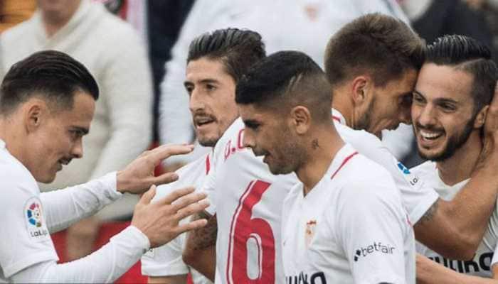 Sevilla edge out Betis 3-2 to go fourth in La Liga