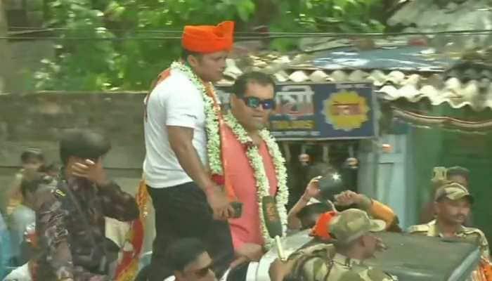 Wrestler Khali joins BJP candidate Anupam Hazra's rally in Jadavpur