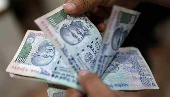 Rupee slips 21 paise to 69.64 vs dollar in early trade