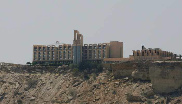 Pakistani forces comb luxury hotel a day after raid killed at least five