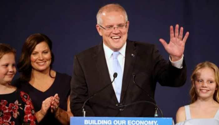 Australia PM struggles to meet tax relief election pledge, central bank urges stimulus