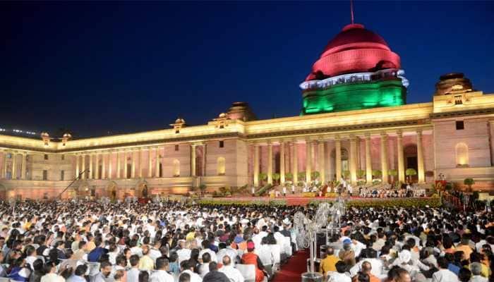 White kurta-pyjama with hues of saffron and Hindi language dominating themes at swearing-in ceremony