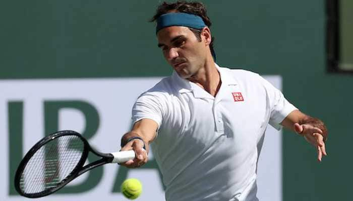 Roger Federer waltzes into French Open last eight