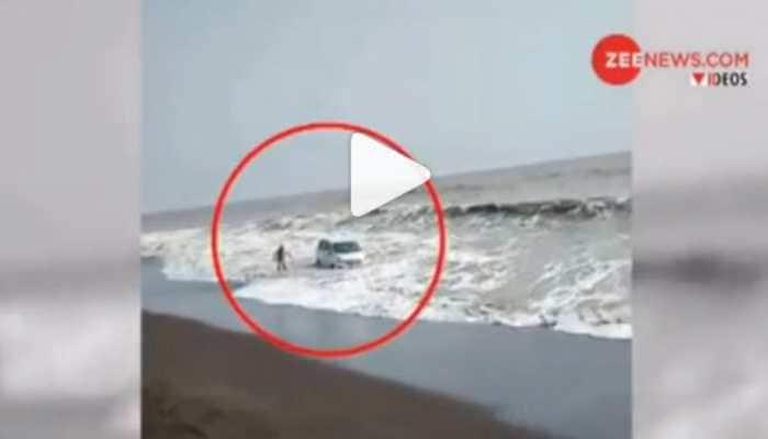Watch: Car goes for a swim near Mumbai beach, tractor turns lifeguard