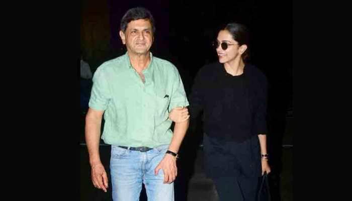 Deepika Padukone refuses to let go of father Prakash Padukone's hand at airport — Pics