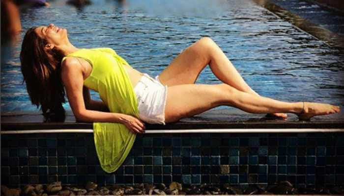 Karishma Tanna dips into the pool, beats summer heat in her own style! Watch