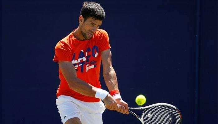 Regular as clockwork, Novak Djokovic eases into Wimbledon third round