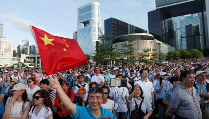 Hong Kong extradition protesters escalate fight in suburbs