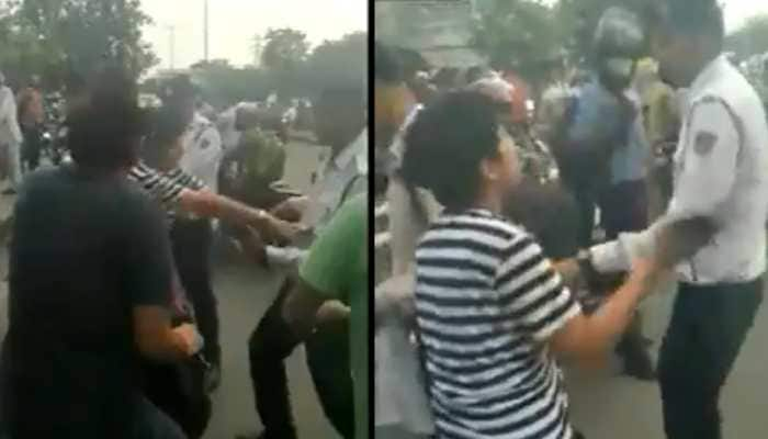 Watch: Stopped for not wearing helmet in Delhi, woman abuses, clashes with traffic cop