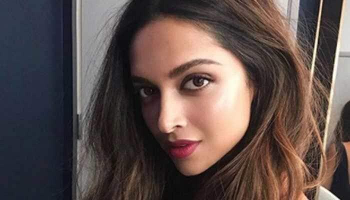 Deepika Padukone obliges young male fan with a photo-op