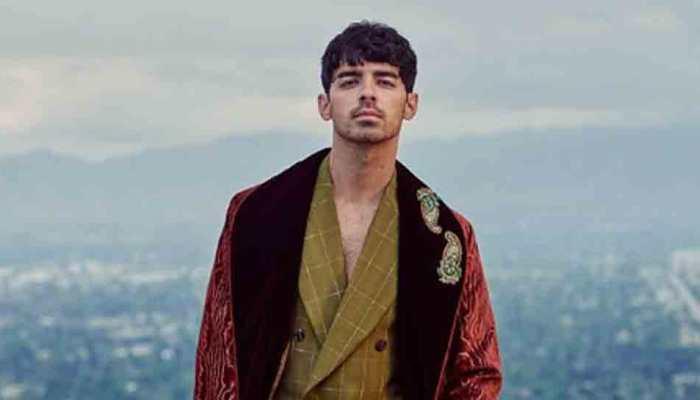 Joe Jonas rings in 30th birthday with Bond theme party