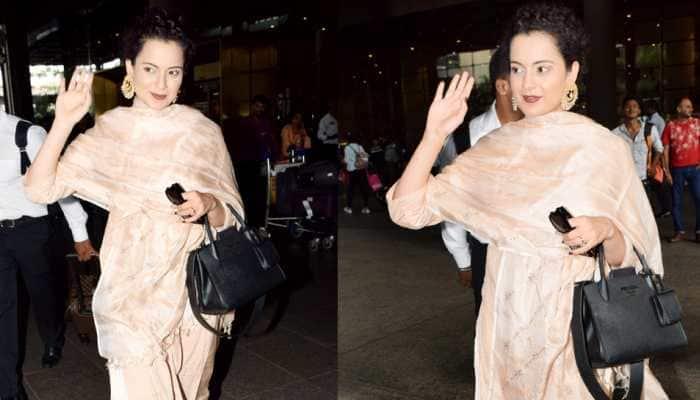 Kangana Ranaut gives desi vibes at airport; flying kisses, hand waves make for a pap-friendly outing—Photos