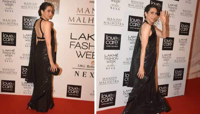 Karisma Kapoor looks alluring in a backless blouse and shimmering black saree—Photos