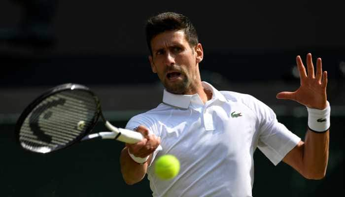 Defending champion Novak Djokovic eases into US Open second round