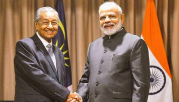 PM Modi meets Malaysian counterpart Mahathir Bin Mohamad in Russia, raises issue of Zakir Naik's extradition