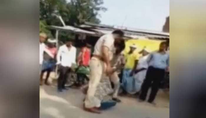 2 police officers suspended for thrashing man over alleged traffic violation