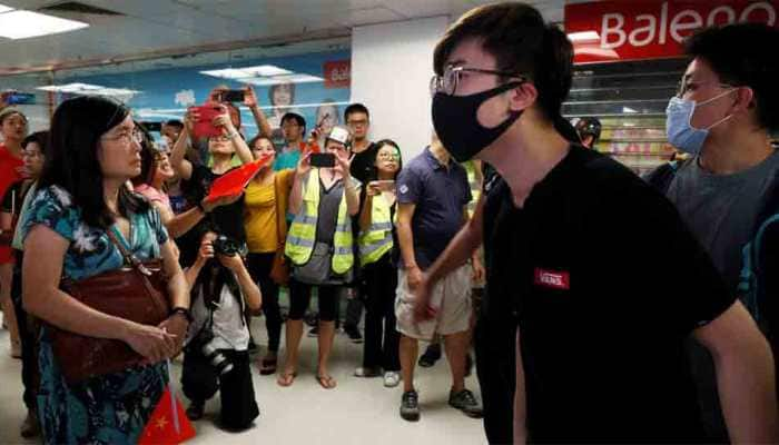 Pro-Beijing groups tear down Hong Kong's protest walls, raising risk of clashes