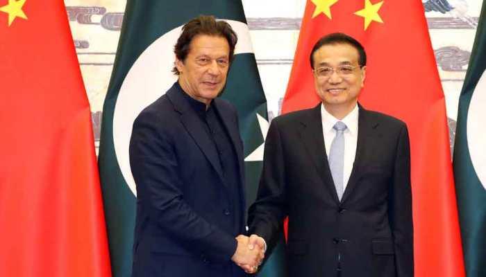 China calls for India-Pakistan talks on Kashmir as Imran Khan meets his Chinese counterpart Li Keqiang