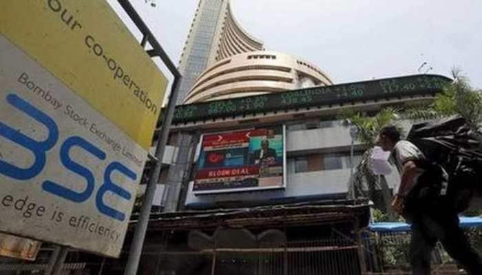 Sensex, Nifty rise; Tata Motors rallies as loss narrows