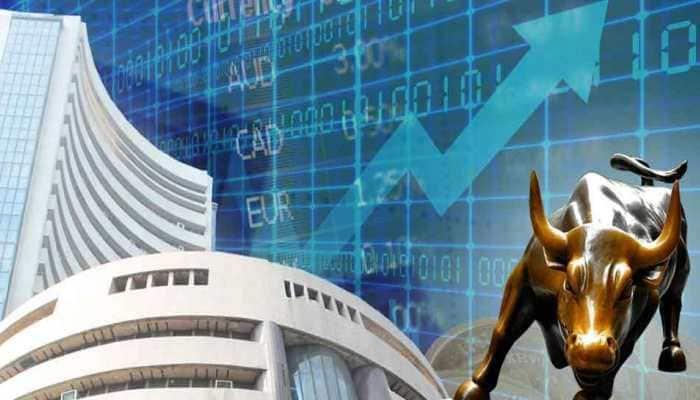 Sensex, Nifty turn flat amid volatile trade; Nifty PSU gains