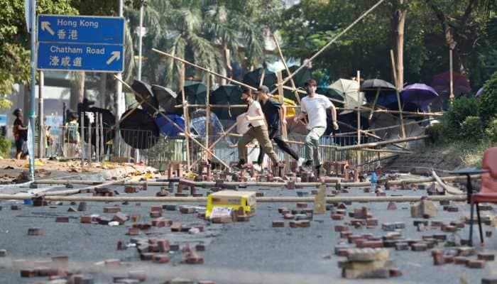 Hong Kong campus holdouts desperately seek escape routes