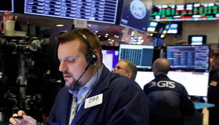 Global Markets: Asian stocks ride Wall Street momentum to eight-month peak, pound slips