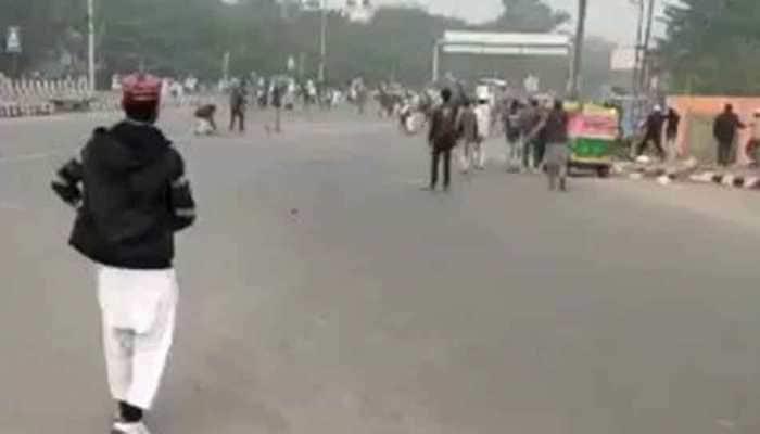 Additional DCP Shahdara Rohit Rajbir Singh attacked with stones during anti-CAA stir in Delhi's Seemapuri - WATCH