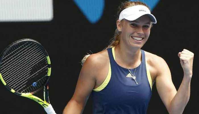 Caroline Wozniacki waves goodbye after third-round defeat at Australian Open