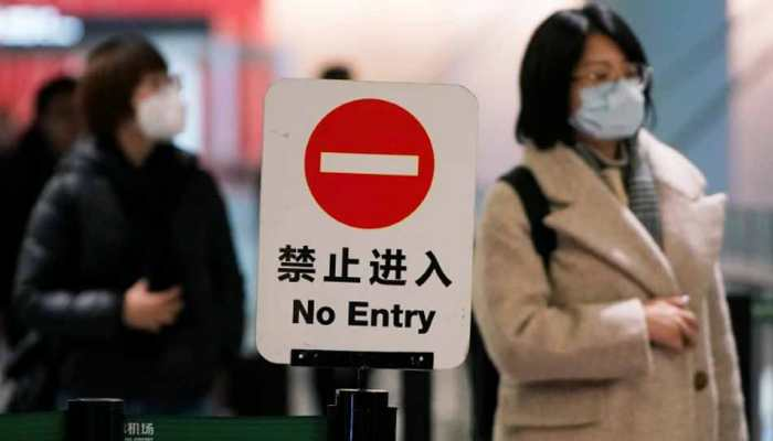 China temporarily suspends entry of foreign nationals holding valid visas from March 28 amid coronavirus COVID-19 outbreak