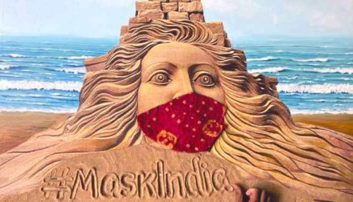 Sand artist Sudarsan Pattnaik urges people to make masks at home through his breathtaking creation