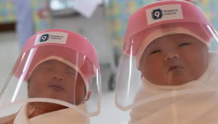 Newborns wear face shields for protection against coronavirus COVID-19 in Thailand hospitals