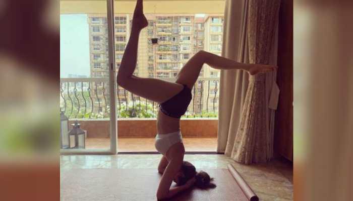 Entertainment news: Karishma Tanna aces the inversion yoga pose