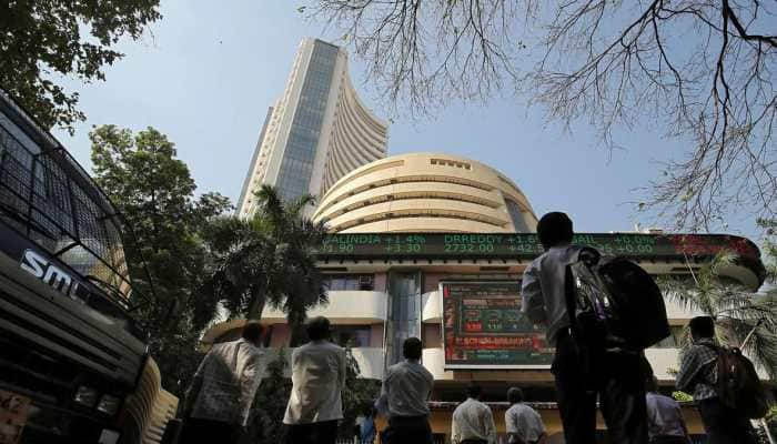 Sensex rallies over 880 points, Nifty tops 9,800 at closing