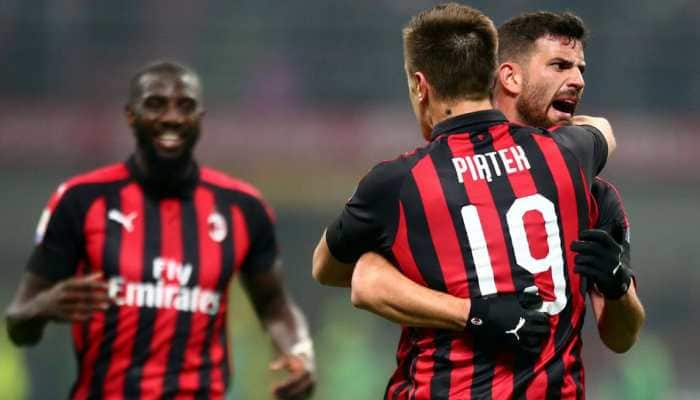 Serie A: AC Milan rescued by stoppage-time own goal against 10-man SPAL