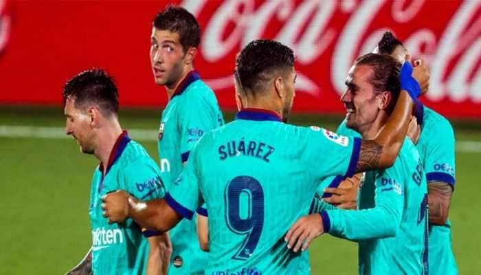 Barcelona outclass Villarreal 4-1 to stay alive in La Liga title race