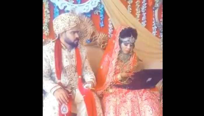 This bride's 'Work from Home' continues at her wedding, groom sits clueless in this viral video breaking internet - Watch