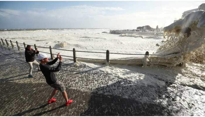 Cape Town promenade witnesses stormy sea foam; attracts, drenches onlookers